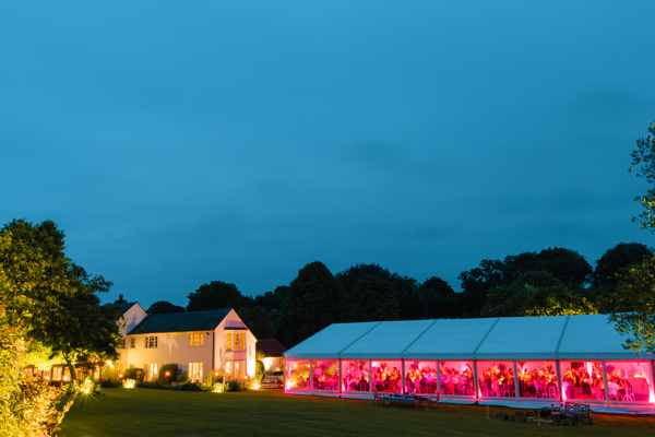Beautiful lighting to marquee, house and garden